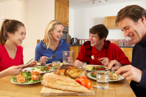 family-having-dinner-at-home-teens