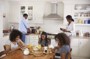 Help Your Teens BigstockFamilyBreakfastDevices-300x199 Screen Time During COVID-19: Raising Humans In A Digital World