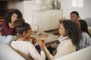 Help Your Teens BigSTockFamilyEatingPizza-300x198 Teen Help: Benefits of Reflexology for Adolescents